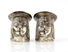Novelty pair of silver cruets, salt and pepper pots in the form of Peruvian natives heads,
