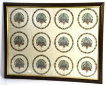Early 19th century silk embroidery with repeating vignettes of peacocks in floral borders,