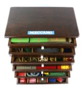 Large collection of Meccano in stained pine six drawer chest, to include, nuts, bolts, metal rods,