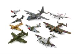 Three Corgi die-cast model aircraft, comprising C130 Hercules, Avro Lancaster in silver and red and