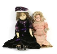 Wax over composition doll with cloth body and painted forelimbs, in velvet dress with bonnet,
