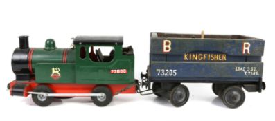 Cast metal model locomotive with rubber wheels and a similar goods wagon, other train related items