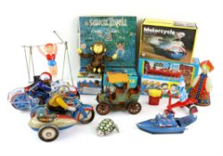 Collection of approximately thirty-three clockwork and friction toys, European and Chinese