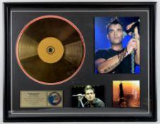 Robbie Williams - Framed presentation display signed by Robbie Williams, framed, 20 x 26 inches.