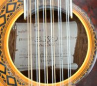 The Beatles - EKO 12 guitar signed by George Harrison on interior label with padded case,