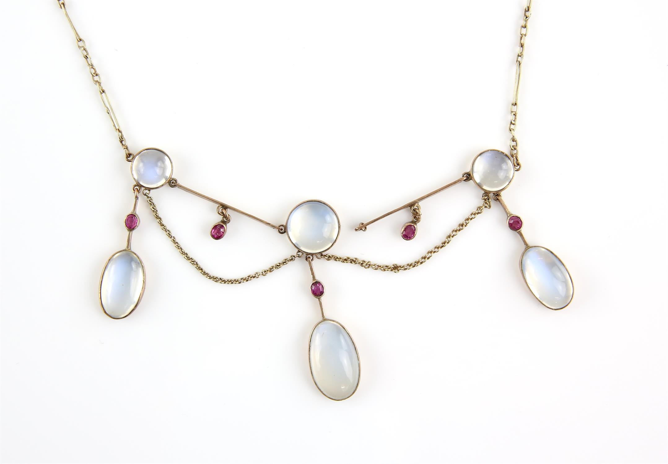 Early 20th C moonstone and ruby fringe necklace, designed as three moonstone drops,
