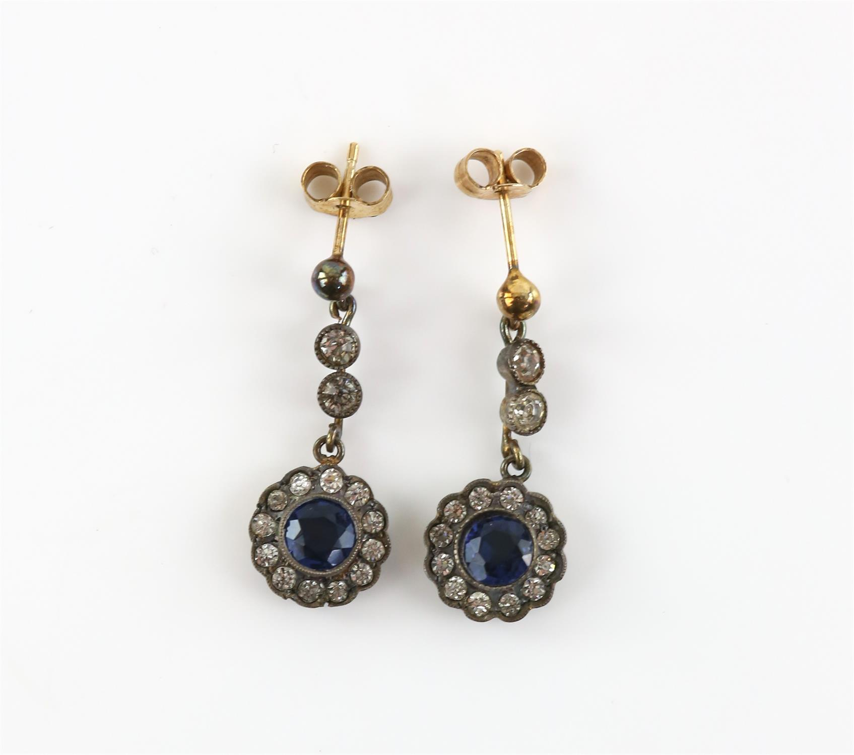 A pair of mother of pearl cufflinks, mounted in 9 ct yellow gold, with a pair of white and blue