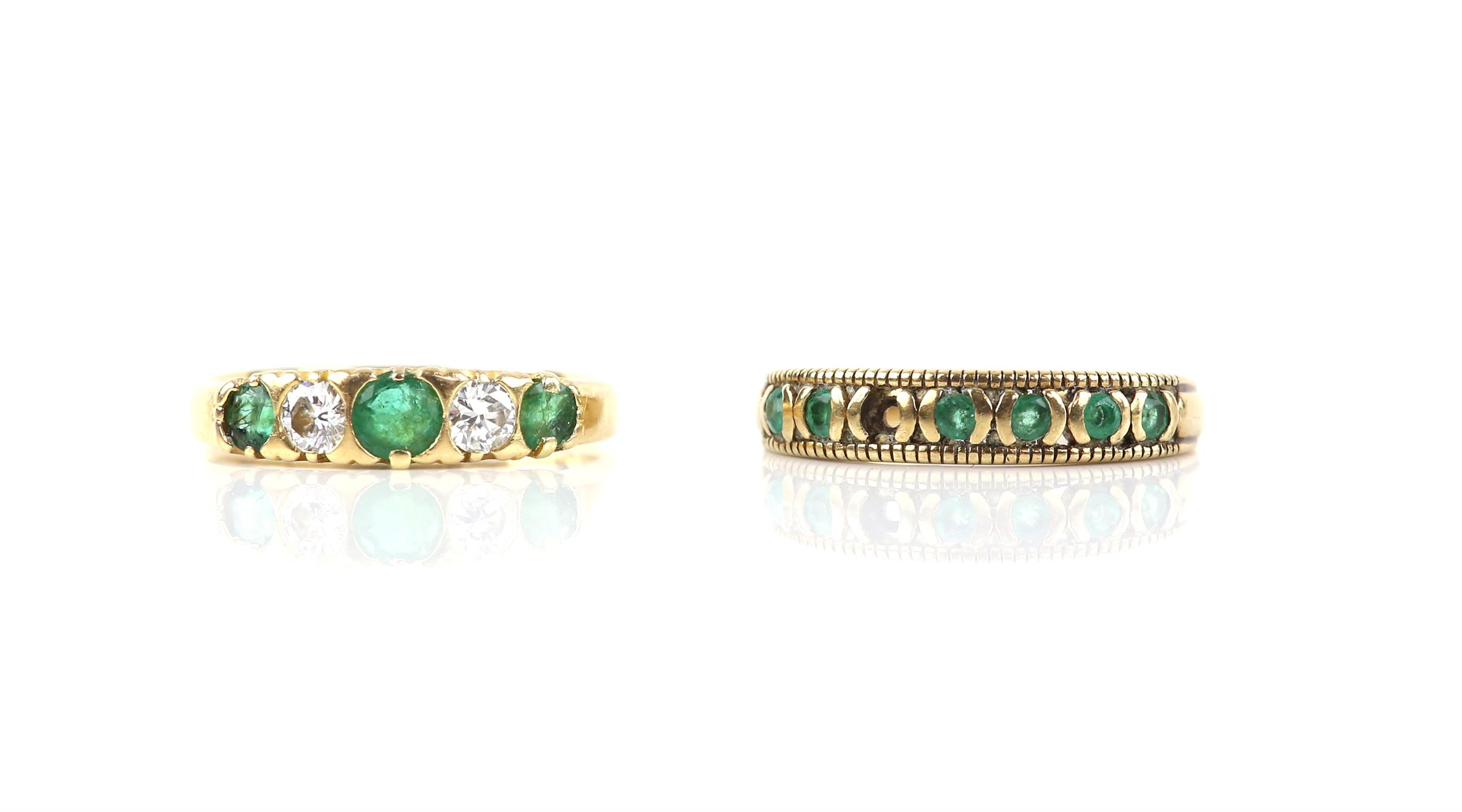 Emerald and diamond five stone ring, set with three round cut emeralds and two round brilliant cut