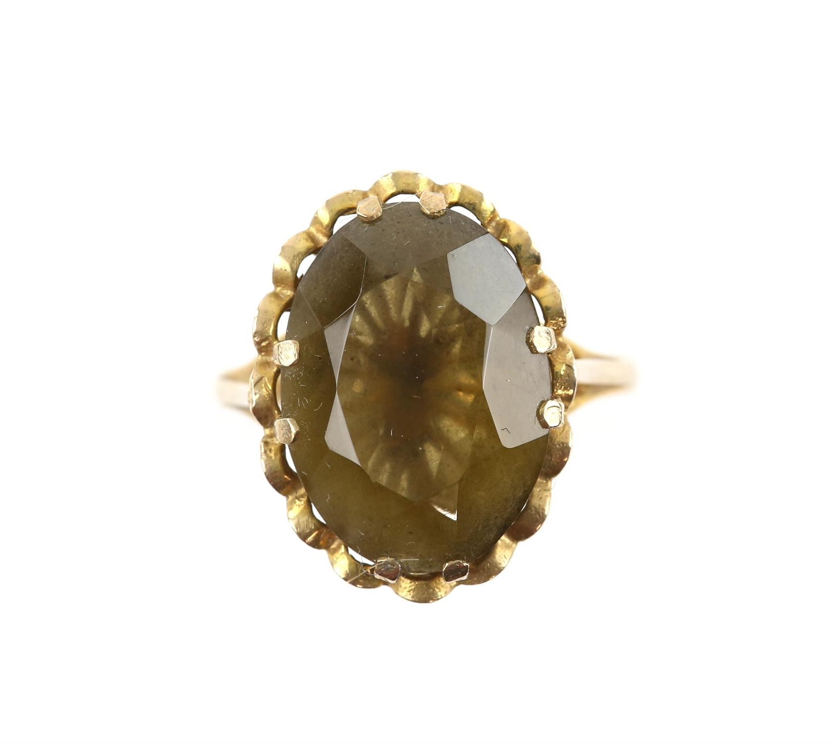 Single stone citrine ring. Oval cut citrine measuring 18.36 x 13.39mm, mounted in 9 ct,