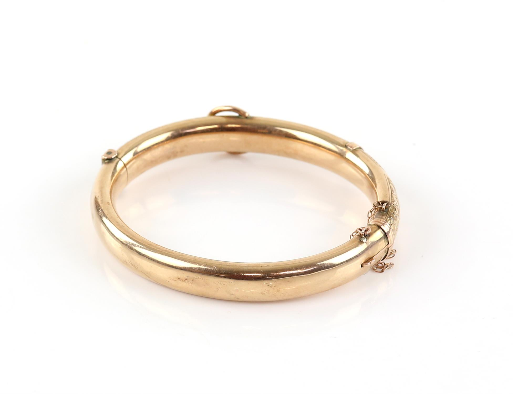 Edwardian gold buckle bangle, engraved with scrolling motif and ivy leaf detailing, - Image 2 of 2