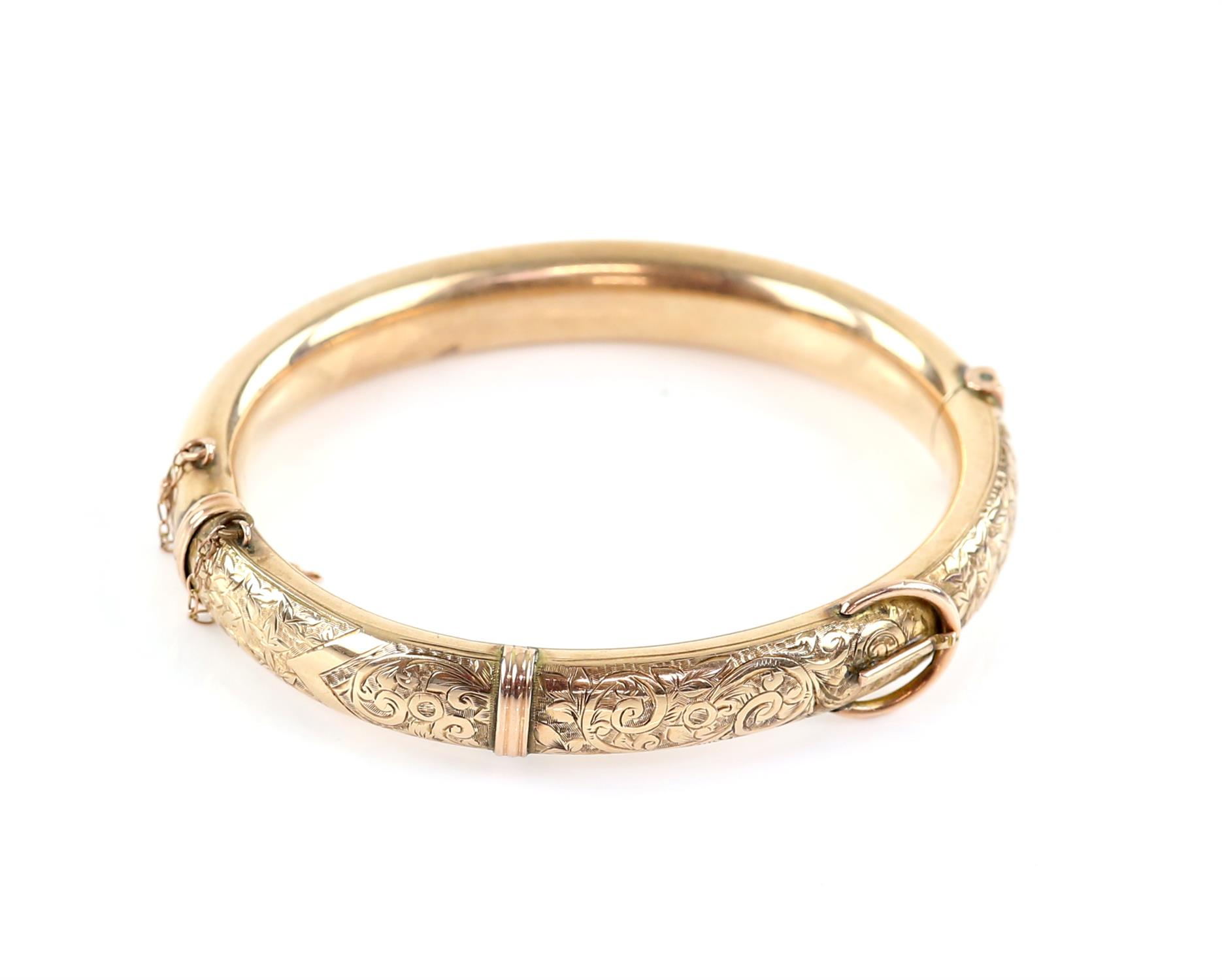 Edwardian gold buckle bangle, engraved with scrolling motif and ivy leaf detailing,