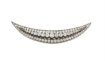 Victorian crescent brooch, set with three row of graduated old cut diamonds, estimated total