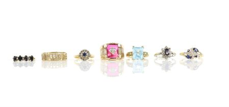 Seven gem set rings, including a sapphire and diamond cluster ring in 18 ct, ring size L1/2,