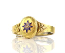 Victorian locket bangle, central oval hinged locket panel, set with blue enamel star on the lid