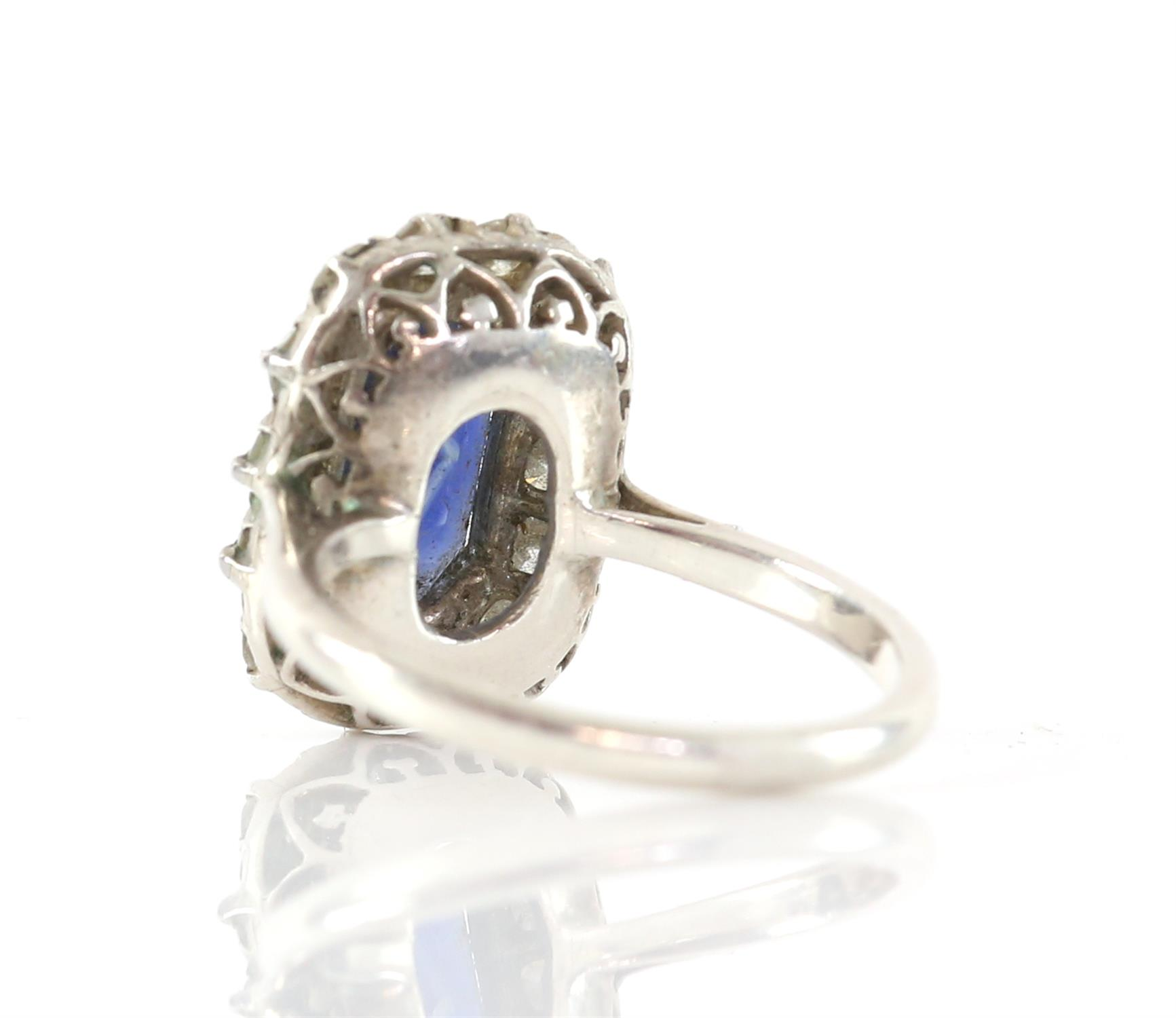 Sapphire and diamond cluster ring, with an emerald cut sapphire weighing an estimated 4.16 carats, - Image 2 of 3