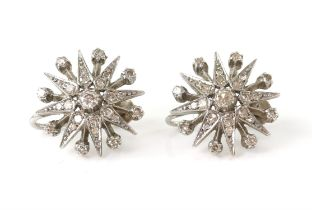 A pair of diamond star earring, set with Swiss cut diamonds, estimated total diamond weight,