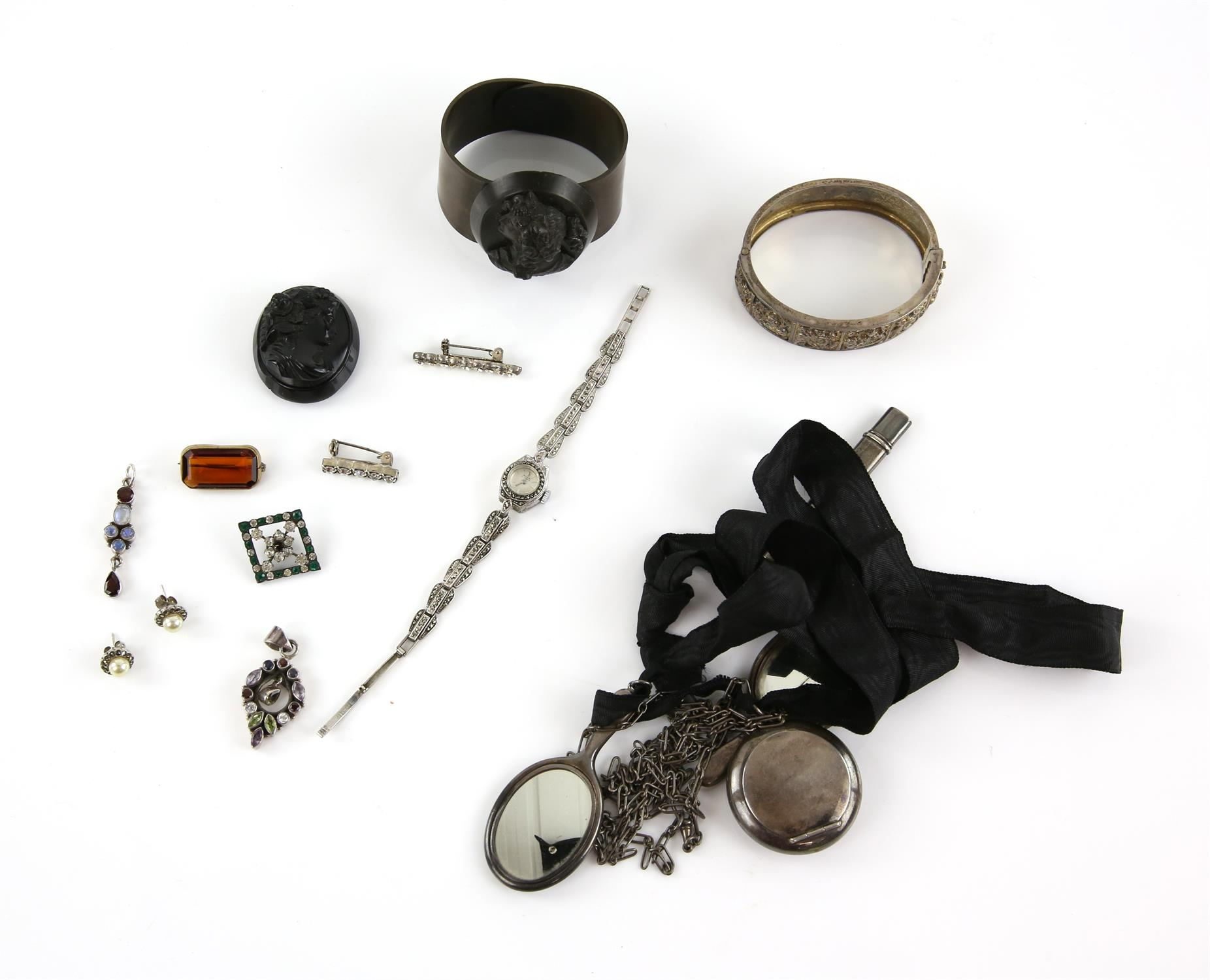 A group of silver items, including bangles, pencil in a silver case, powder compact and small