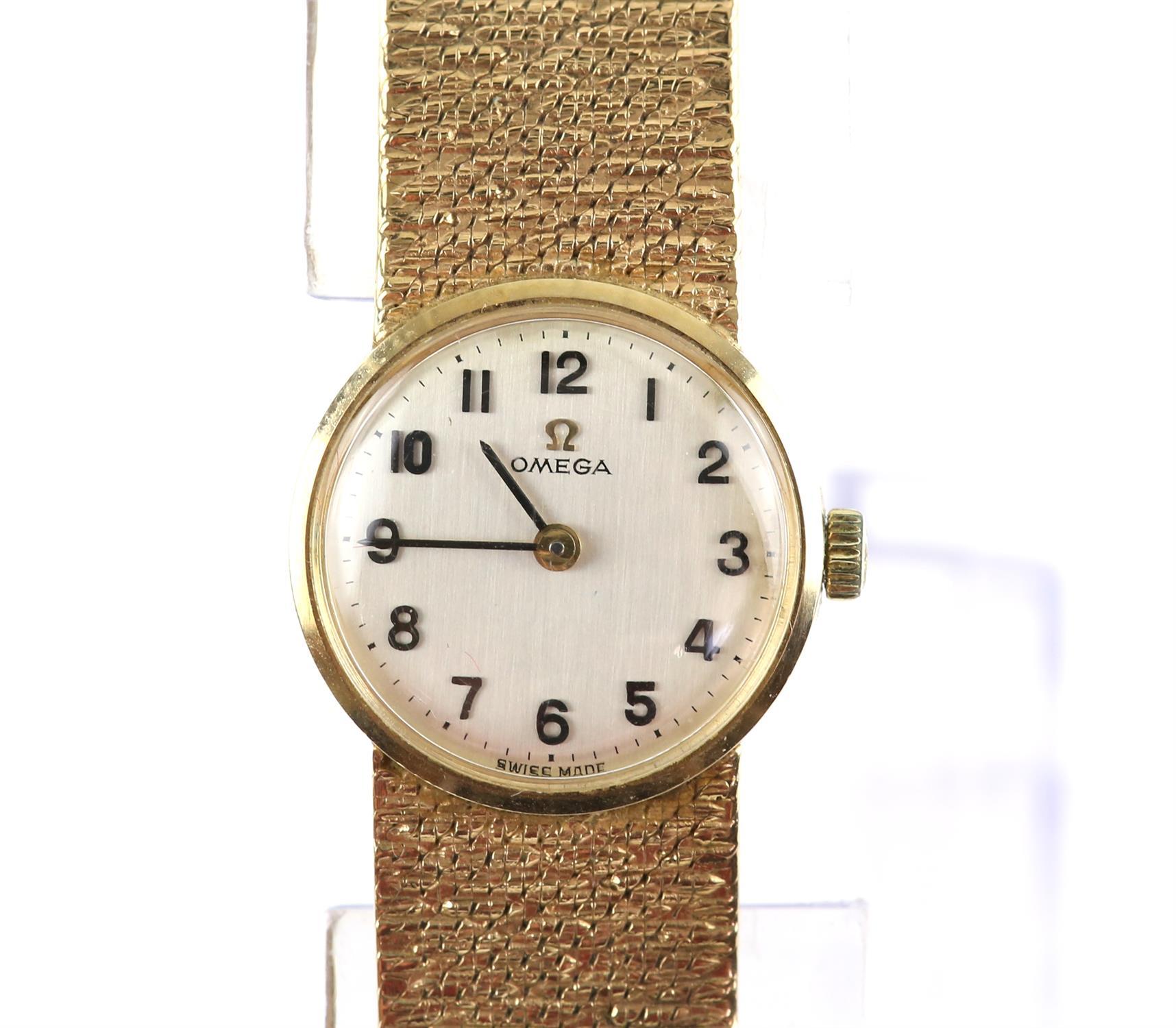 Vintage Omega watch, quartz movement, bracelet strap with textured bark finish, satin finish off