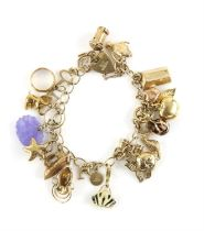Vintage charm bracelet, with approximately twenty-five charms, mainly 9 ct, including binoculars,
