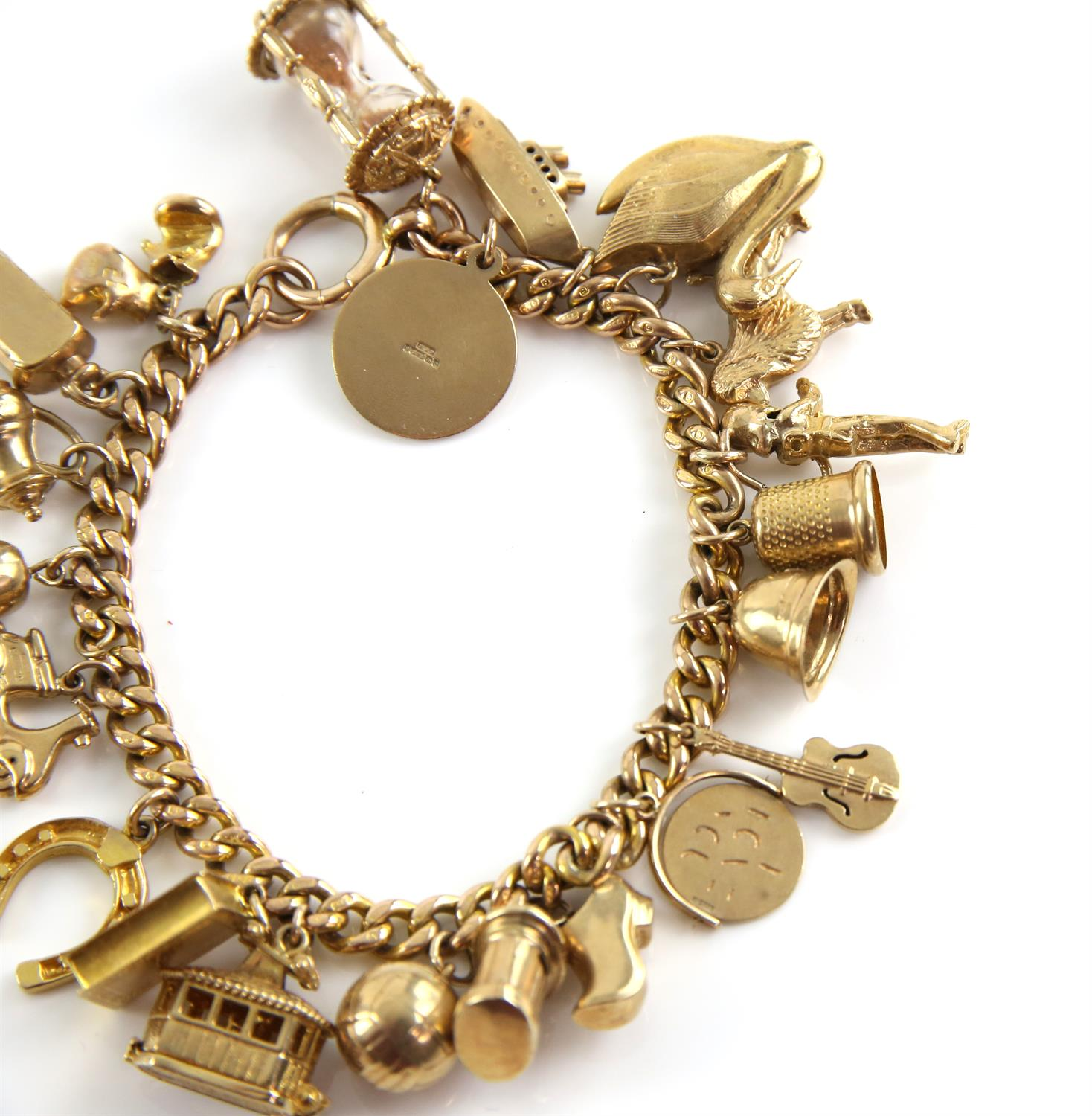 Gold curb link bracelet, large bolt ring clasp, with twenty-one vintage charms attached, - Image 2 of 3