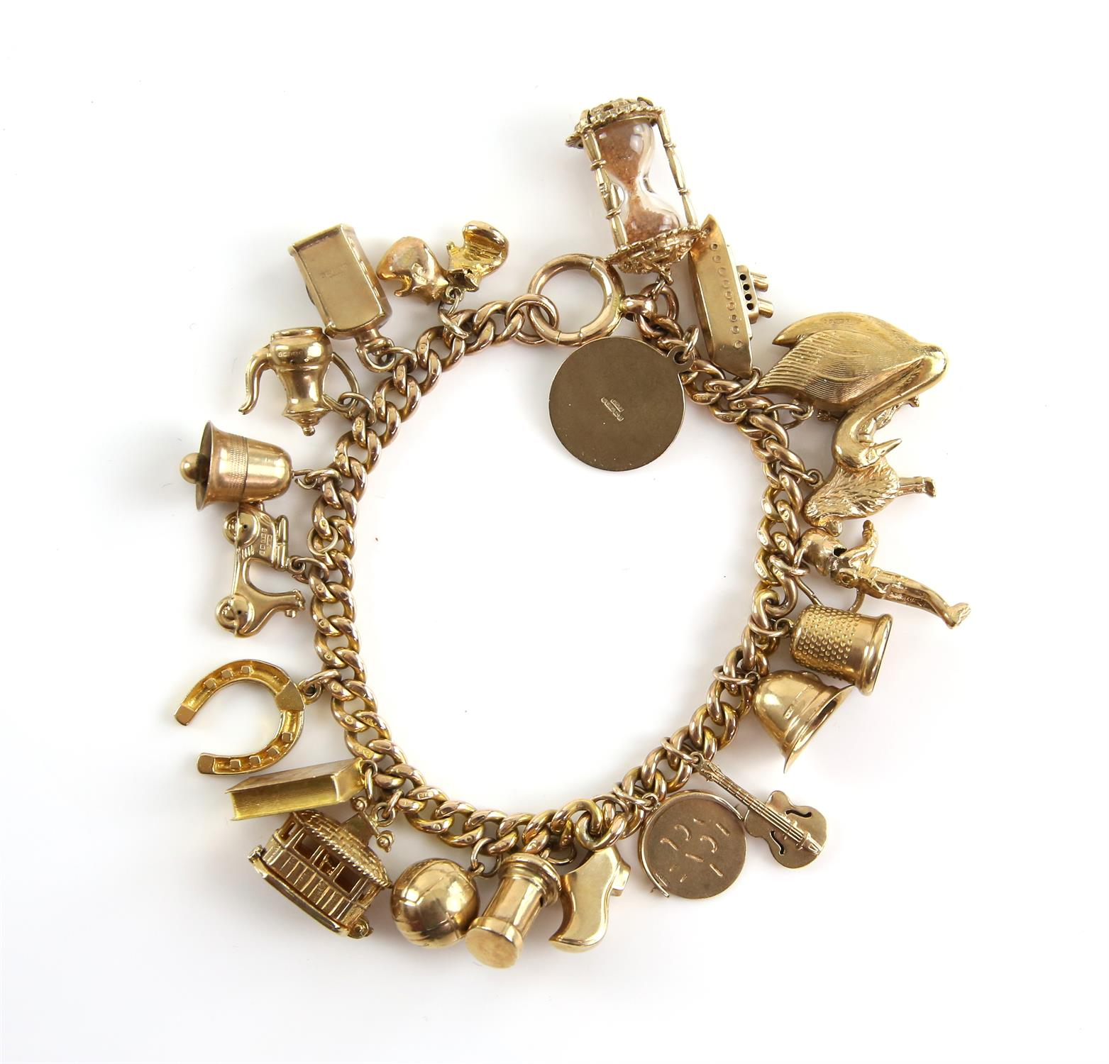 Gold curb link bracelet, large bolt ring clasp, with twenty-one vintage charms attached,