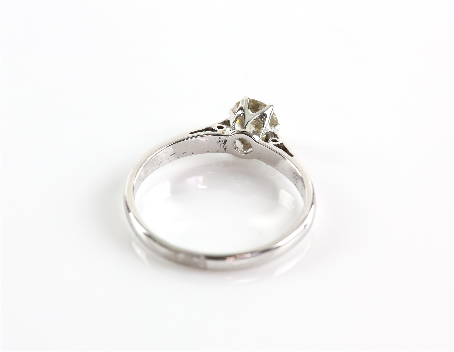 Diamond single stone ring, round brilliant cut diamond weighing an estimated 0.68 carats, claw set, - Image 3 of 3