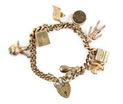 Vintage charm bracelet, flat curb links with a heart padlock clasp and safety chain,