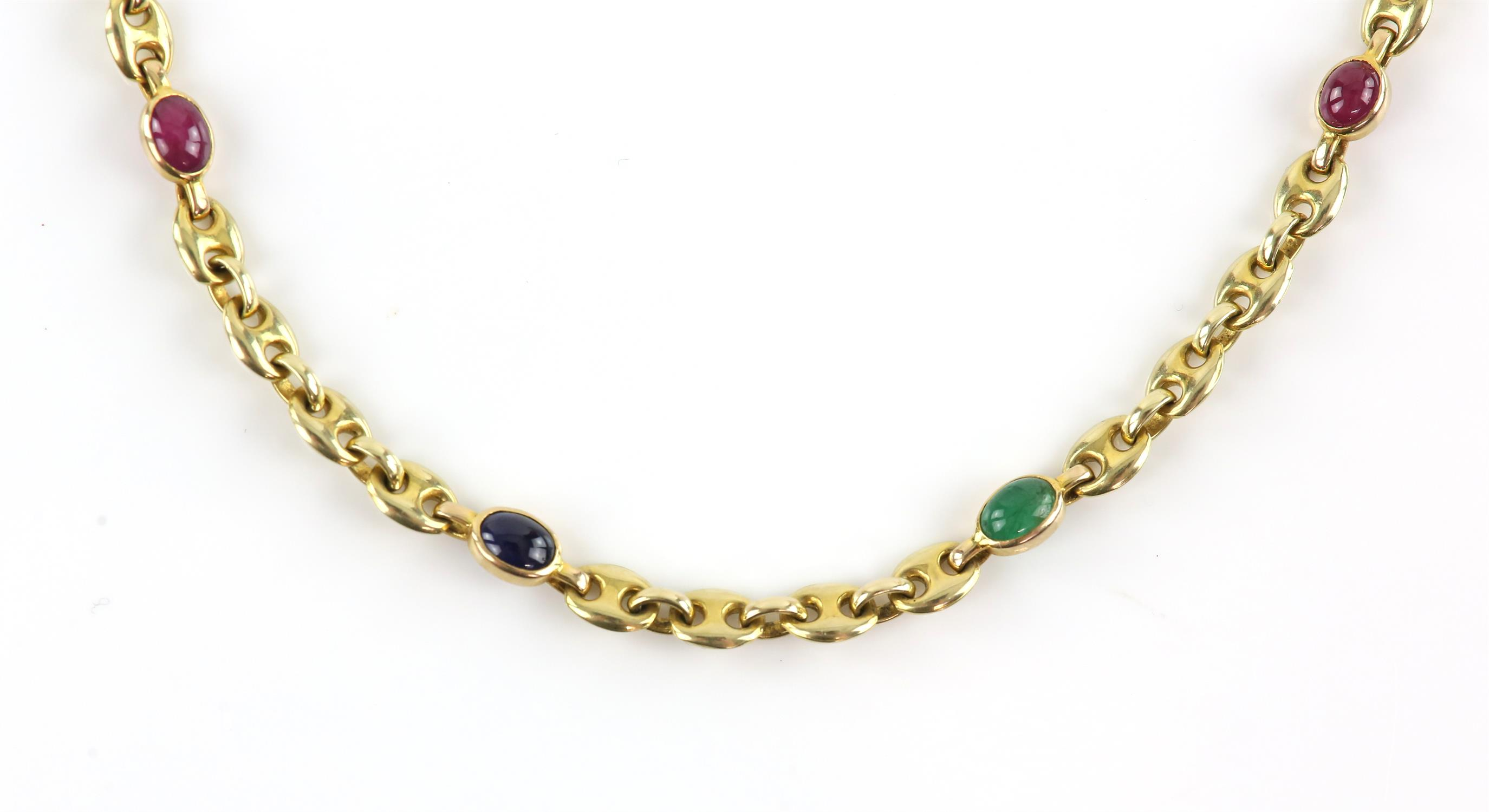 Anchor link chain, with cabochon cut rubies, sapphires and emeralds spaced throughout,
