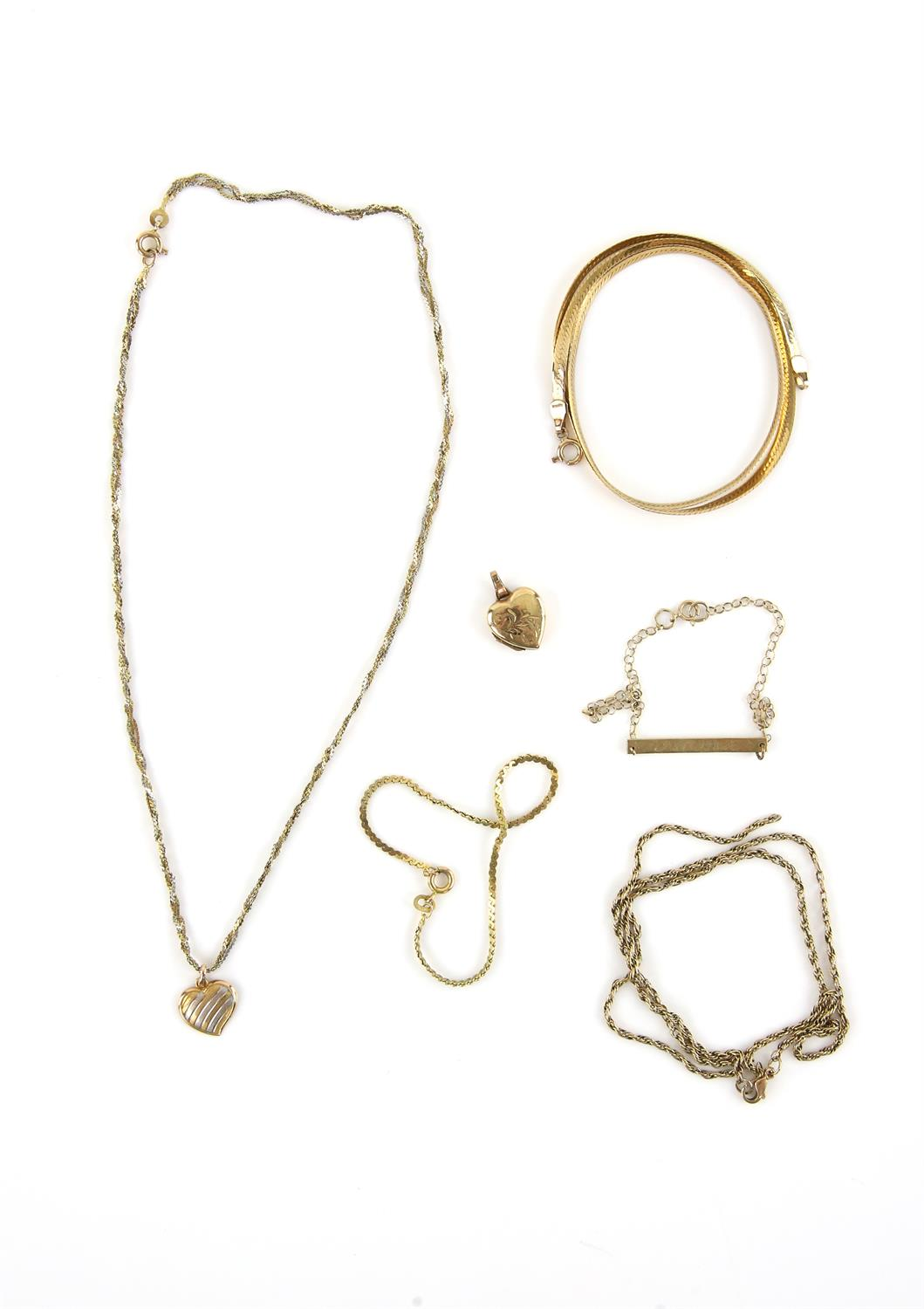 A group of gold jewellery, including a heart locket, a bi coloured heart pendant on a fancy link