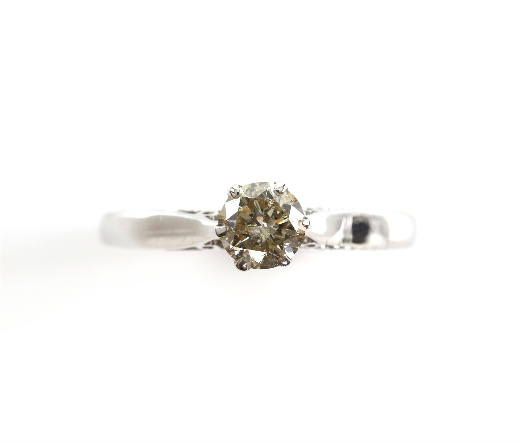 Diamond single stone ring, round brilliant cut diamond weighing an estimated 0.68 carats, claw set,