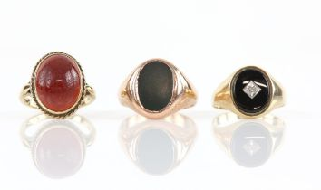 Three gem set rings, including a bloodstone signet ring, ring size R1/2, an onyx and diamond signet