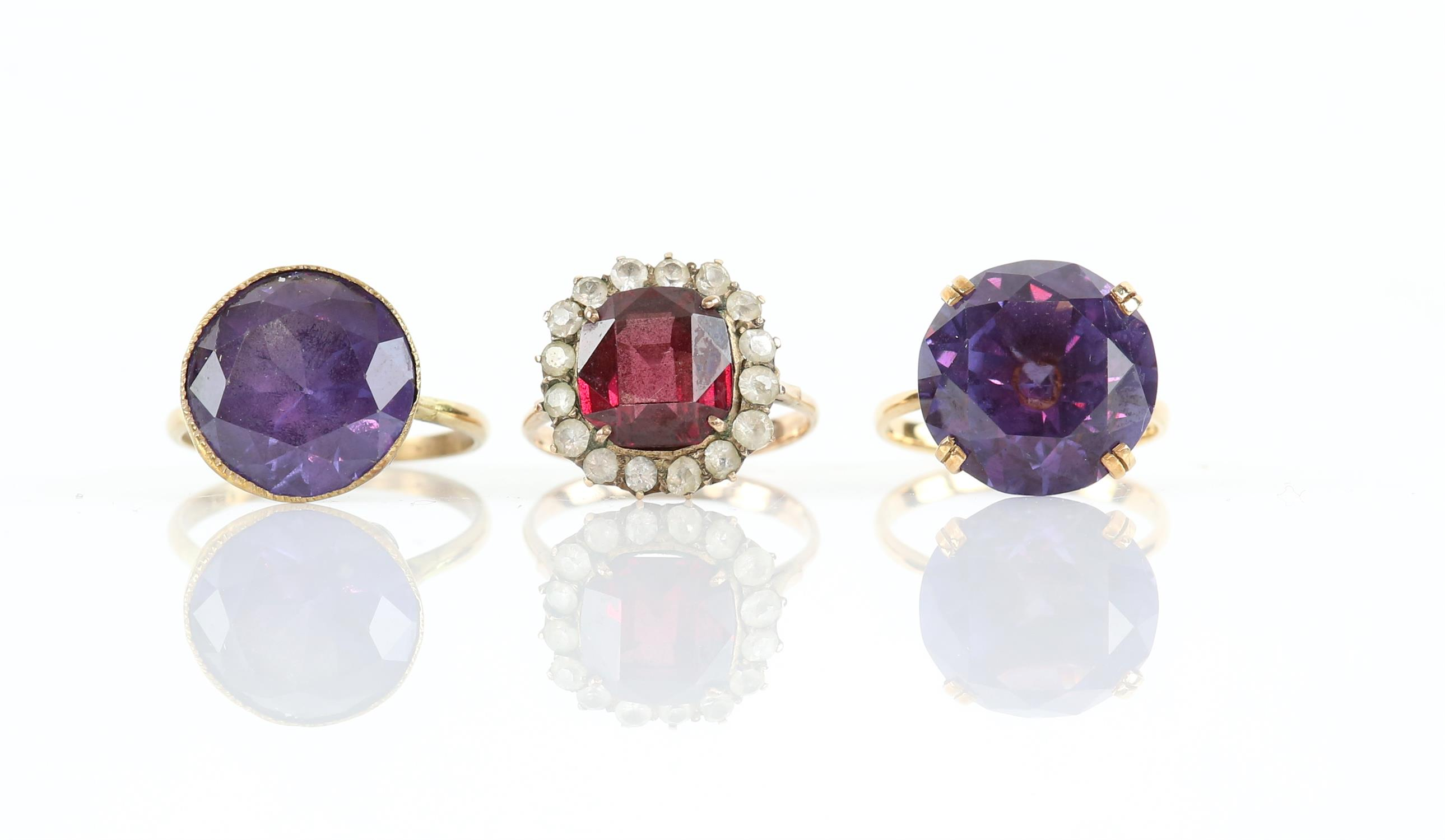 Three gem set rings, comprising two single stone synthetic colour change sapphire rings,