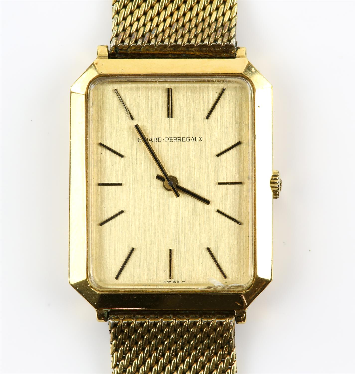 Girad-Perregaux A gentleman's wrist watch, the rectangular signed brushed gold signed dial case