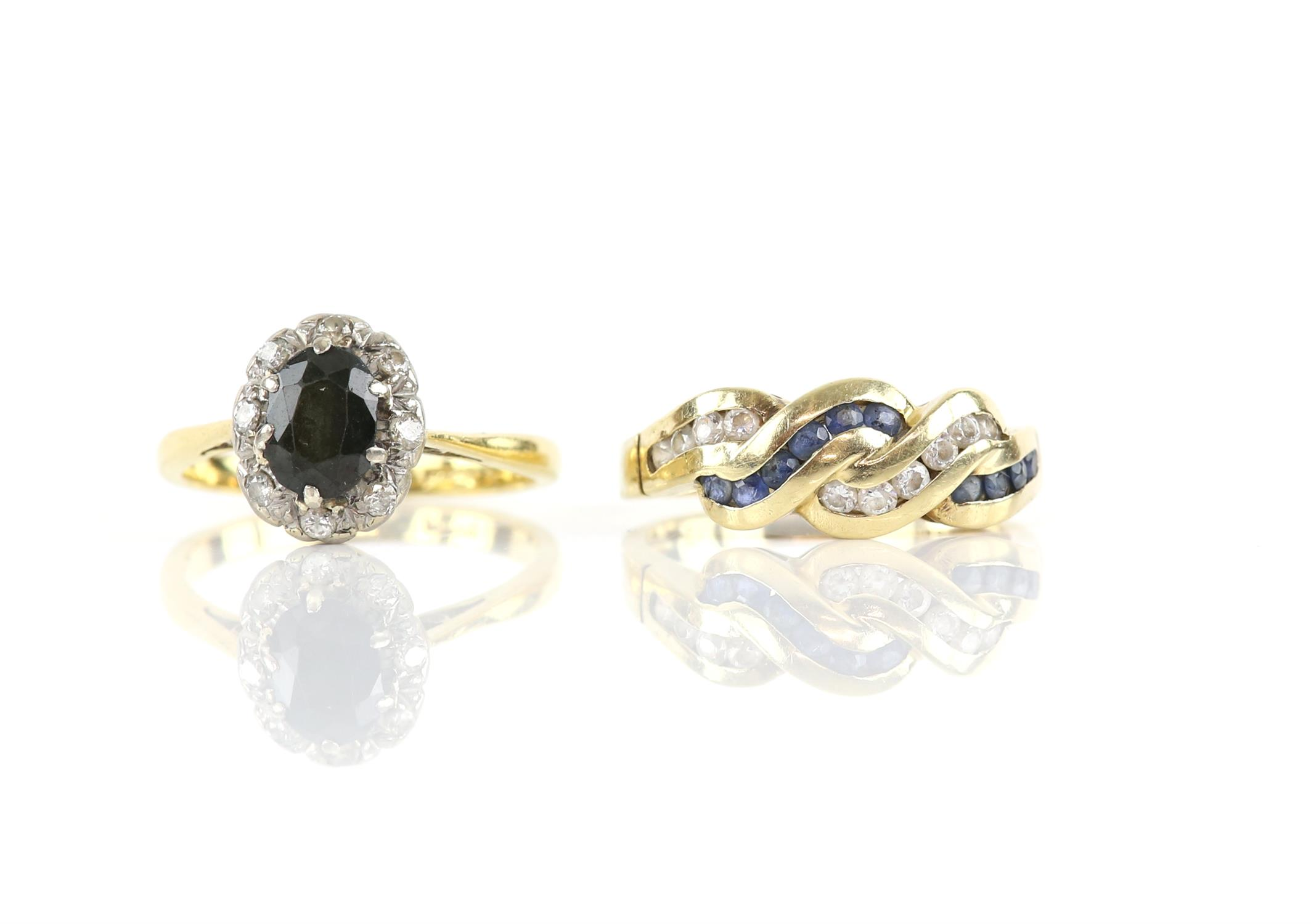 Sapphire and diamond cluster ring, oval cut sapphire, surrounded by round brilliant cut diamonds,