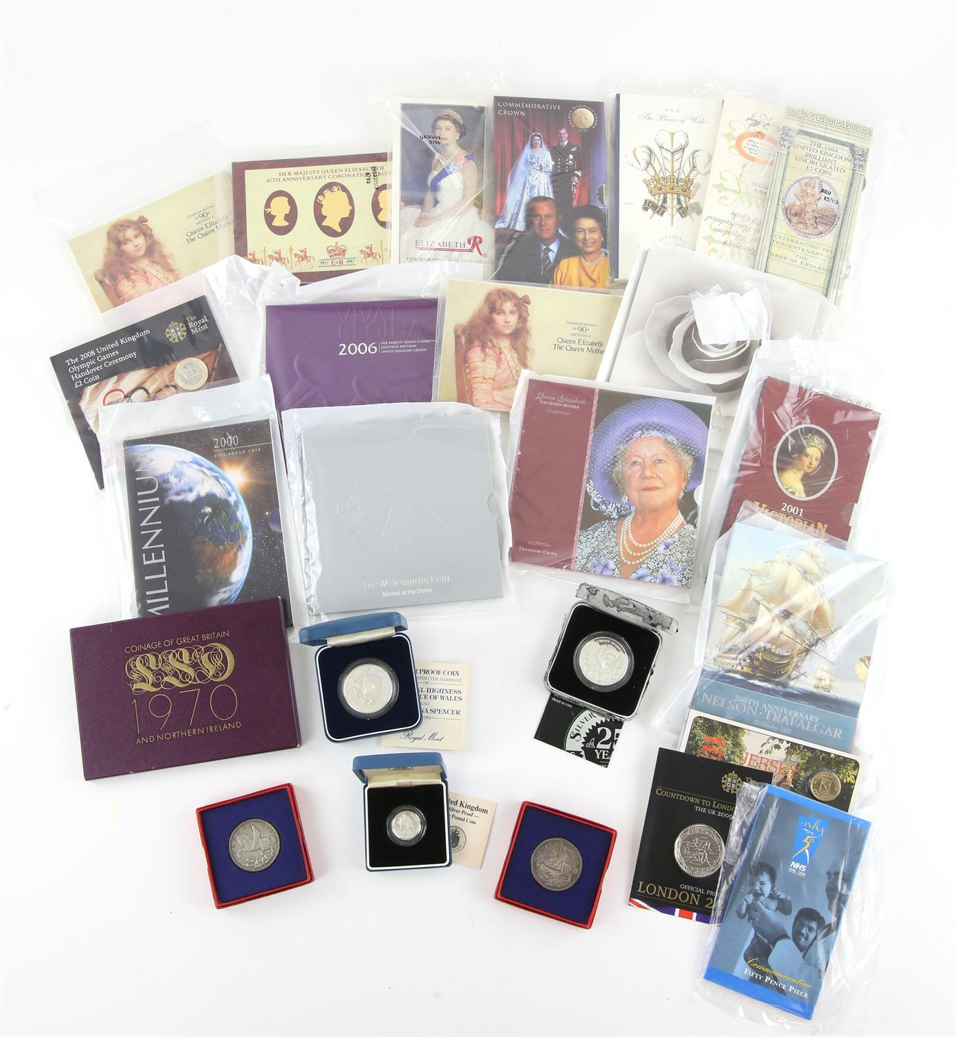 Collection of mostly British Brilliant Uncirculated coins in original Royal Mint presentation flat