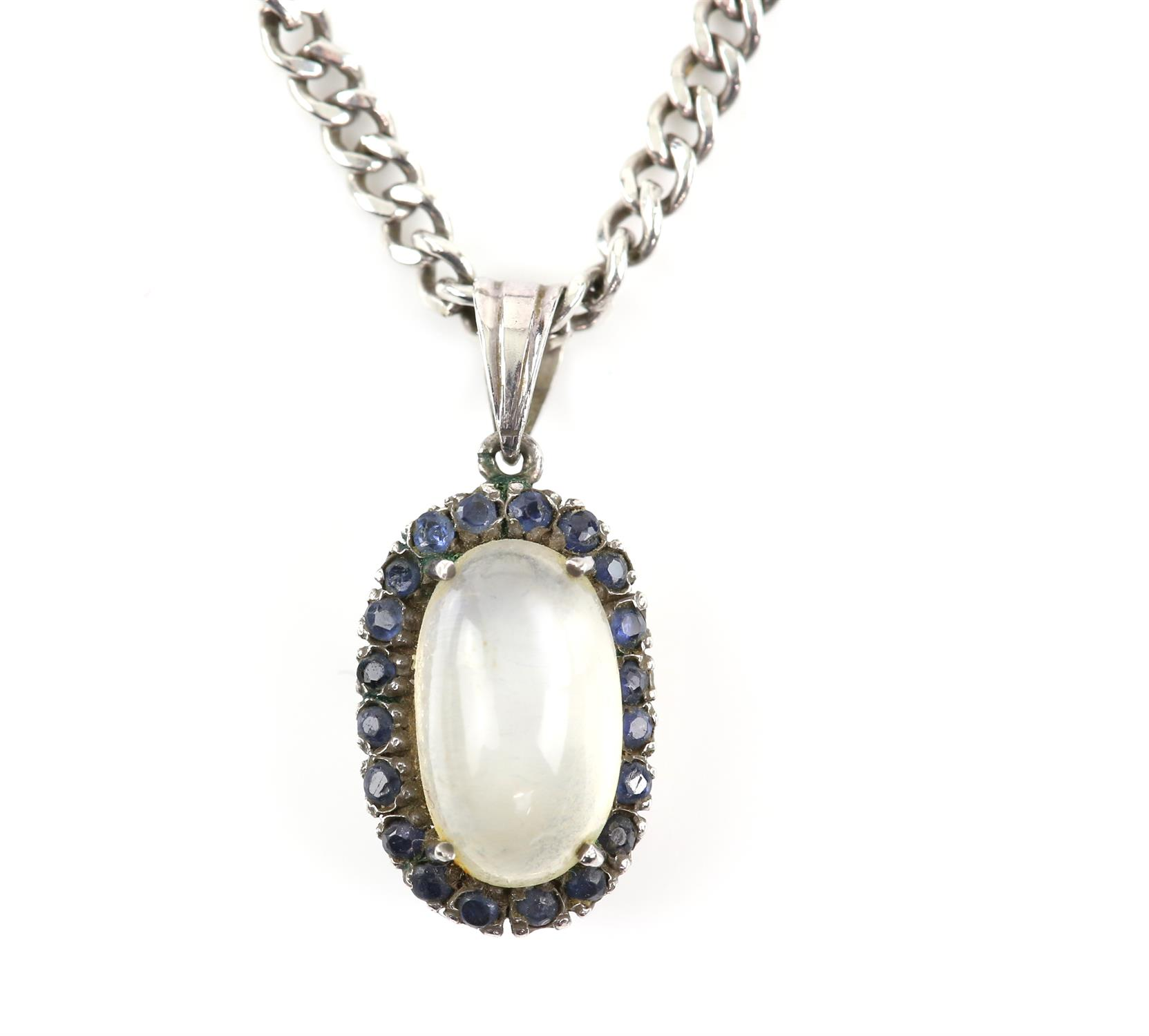 Moonstone and sapphire cluster pendant, central oval cabochon cut moonstone, 12 x 7.