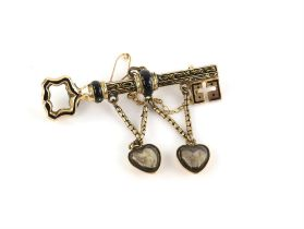 Victorian key brooch, with black enamel floral detailing, two suspended heart lockets containing
