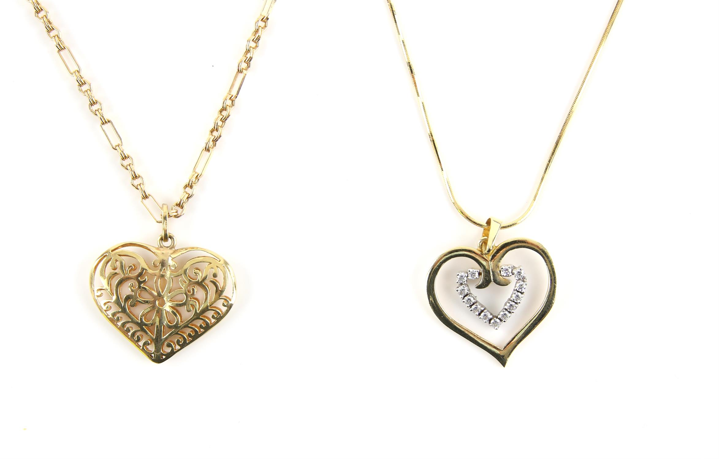 Two heart necklaces, including a filigree puff heart on a fancy link chain, in 9 ct,