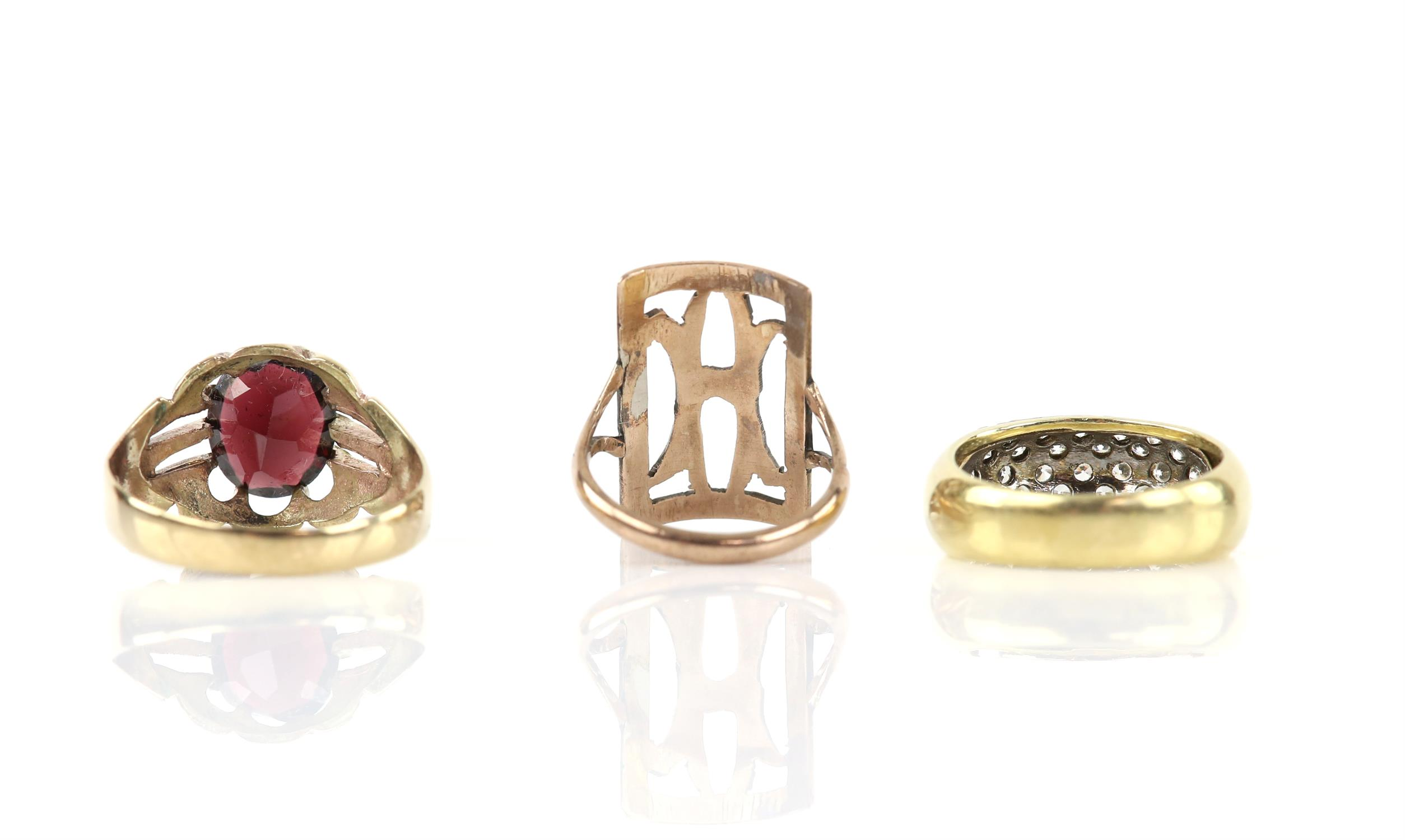 Three rings, including a single stone garnet ring, in 9 ct, ring size W, a multi stone cubic - Image 2 of 2