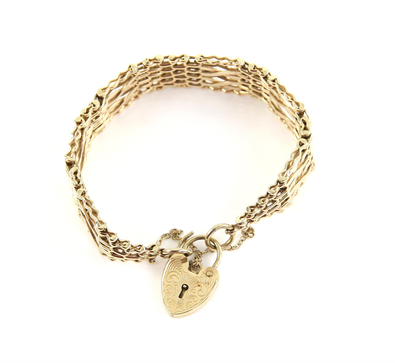 Vintage gold gate bracelet with fancy gold links with sections of brick link between,