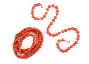 Two coral necklaces, one long bead necklace strung on a chain, with a gilt metal clasp,