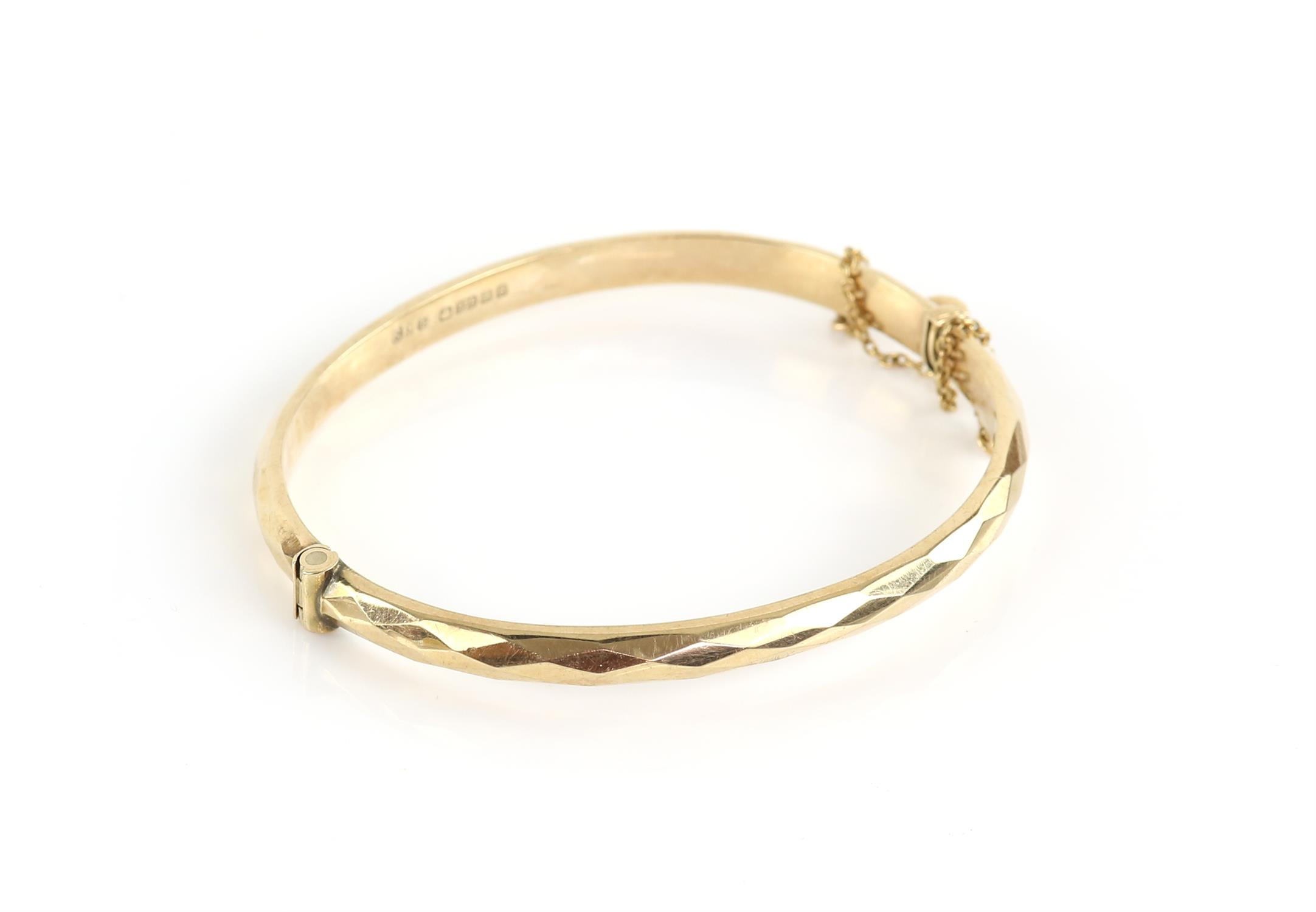 Vintage hinged bangle, diamond cut design to the outer edge, mounted in 9 ct gold,