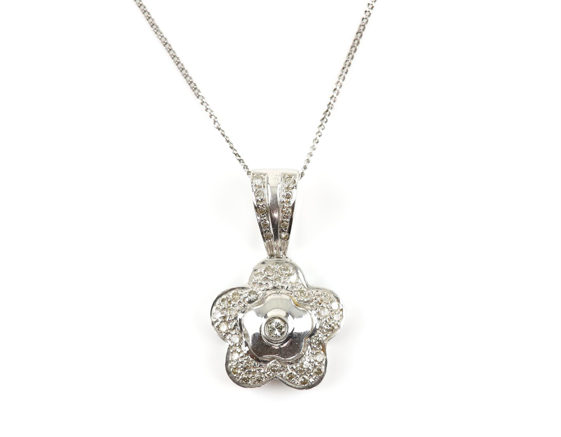 Diamond flower pendant, set with round brilliant cut diamonds, on a diamond set bail,