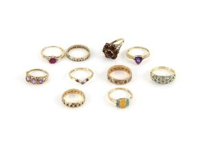 Ten gem set rings, including a garnet cluster ring, size N, a heart shaped ruby ring, size N,