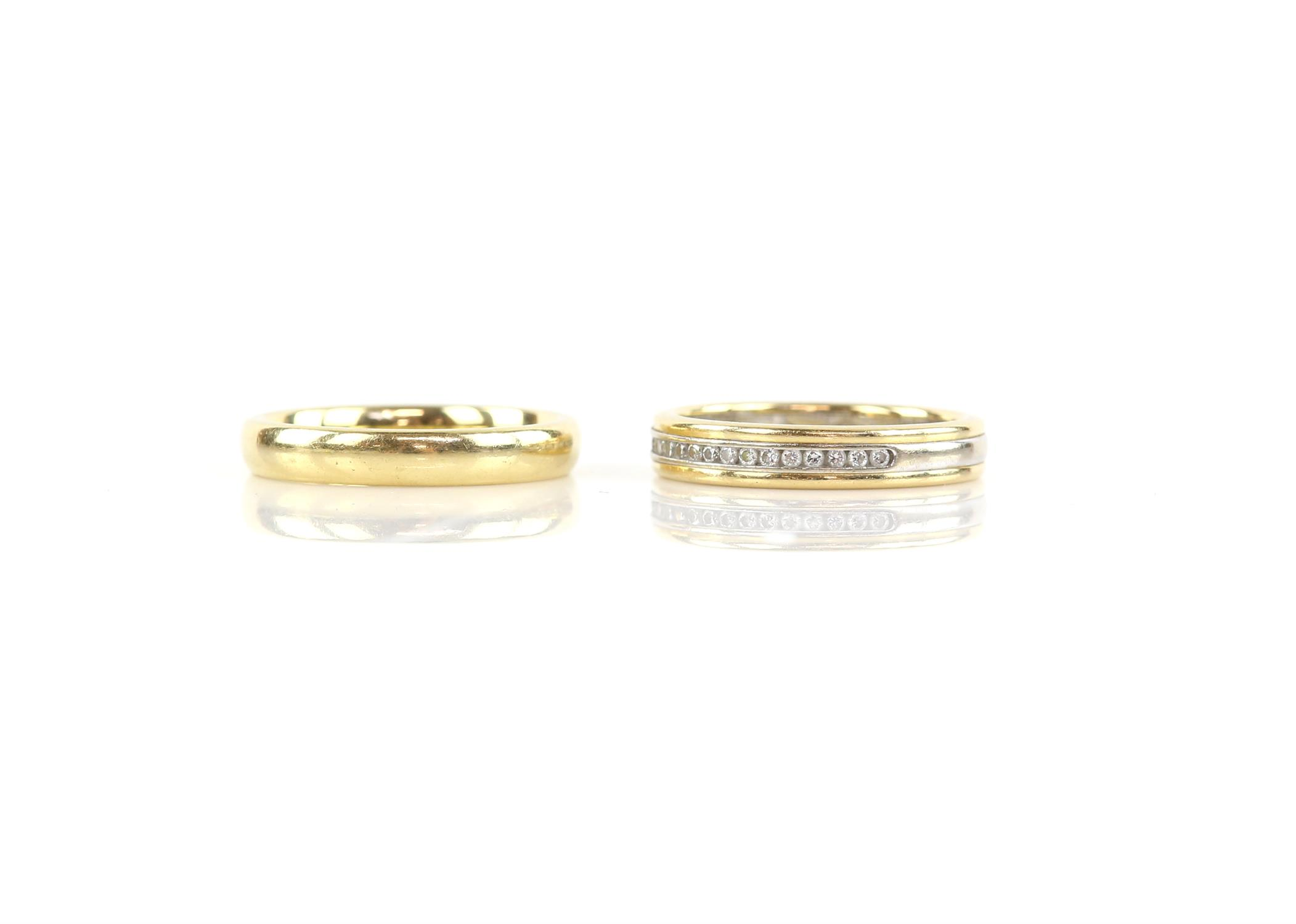 Two rings, a diamond set half eternity ring, size K 1/2, inside band marked Pravins and a court