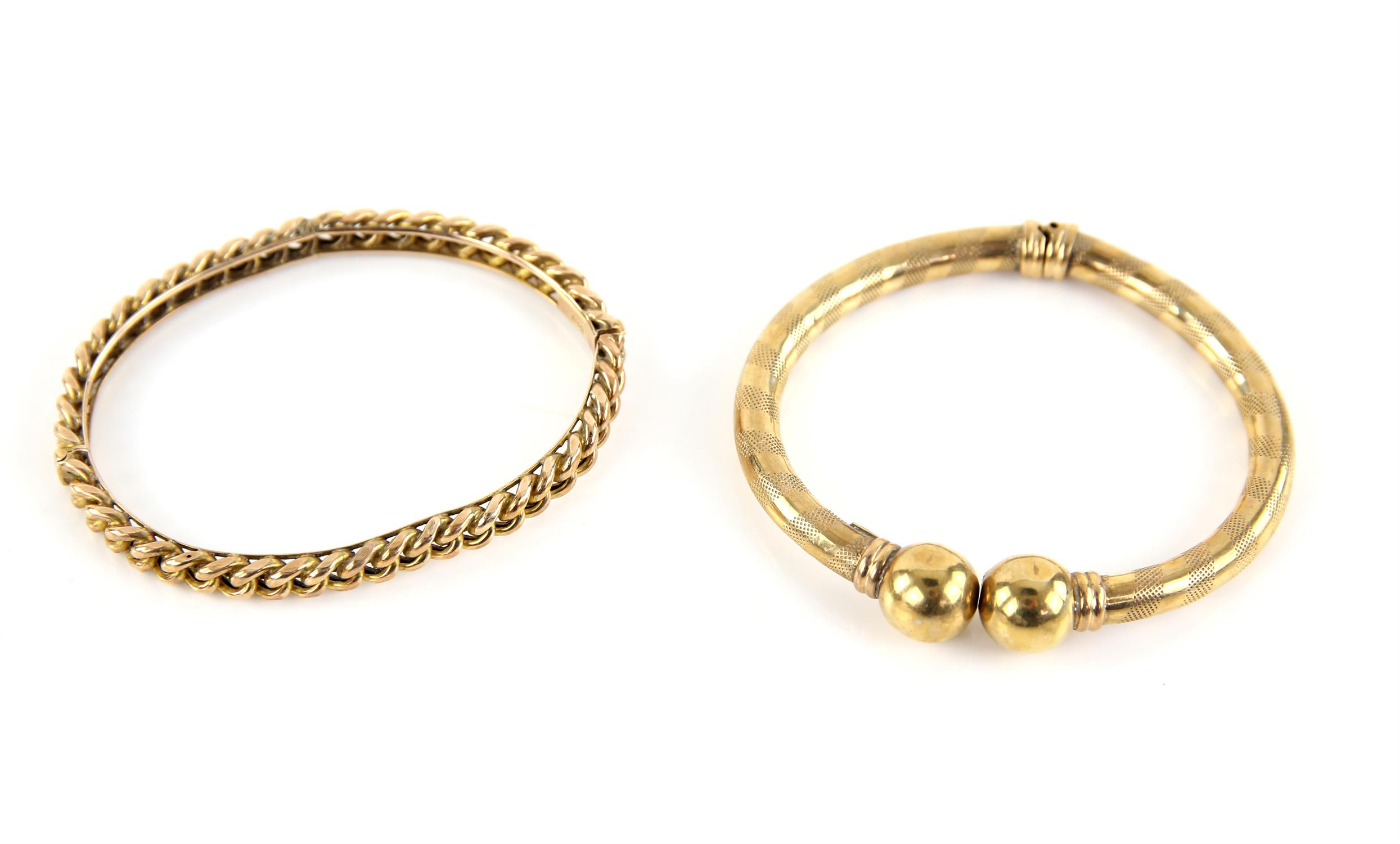 Curb link style hinged bangle, stamped 10 ct, inside diameter 63 x 47mm, together with a broken