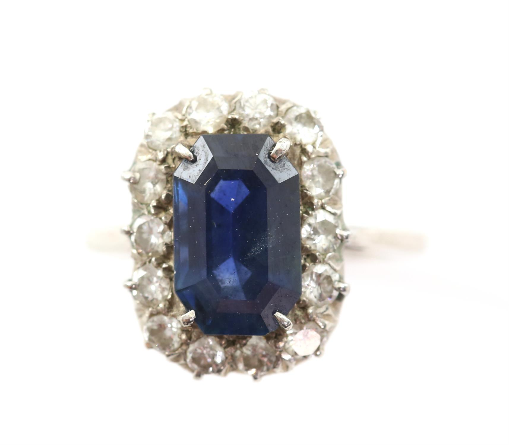 Sapphire and diamond cluster ring, with an emerald cut sapphire weighing an estimated 4.16 carats, - Image 3 of 3