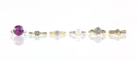 Six gem set rings, including a single stone diamond ring, weighing an estimated 0.20 carat,