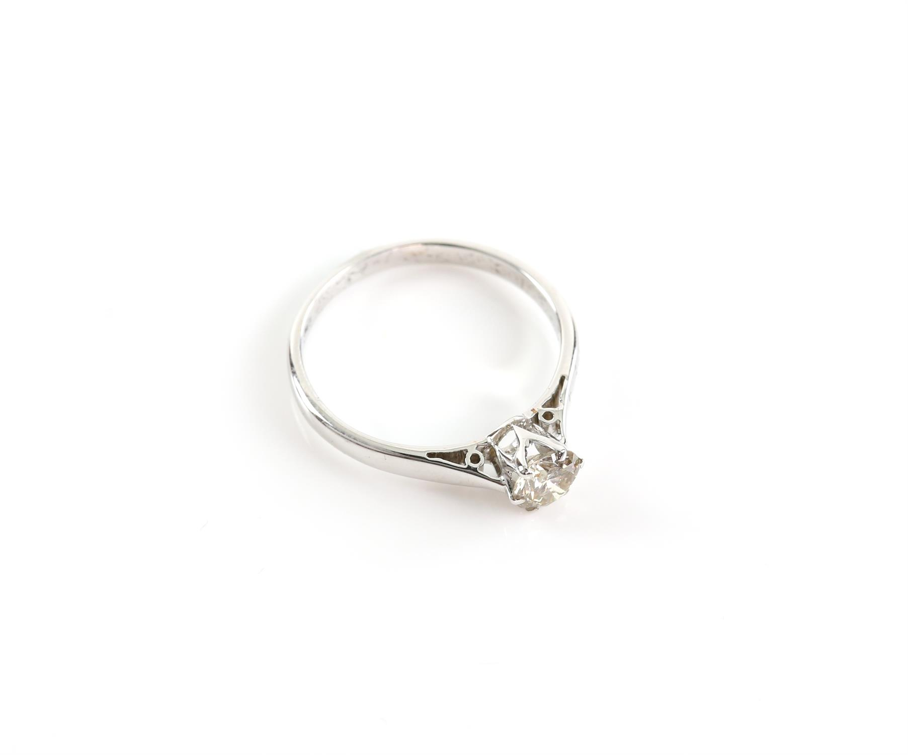 Diamond single stone ring, round brilliant cut diamond weighing an estimated 0.68 carats, claw set, - Image 2 of 3