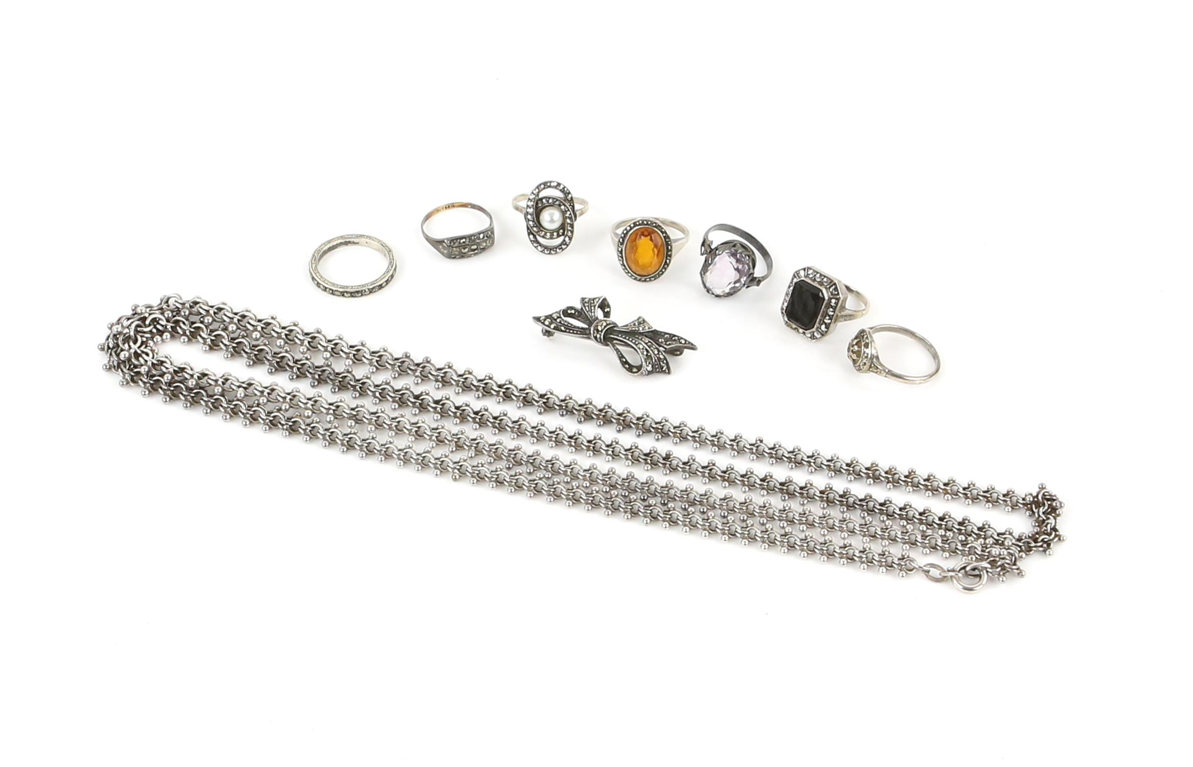 A group of costume jewellery, including a long fancy link necklace, 89cm in length,